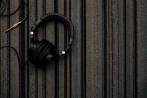headphones on a rug