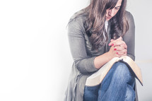Woman praying with open bible
