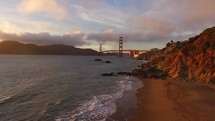 drone view of the beach and Golden Gate bridge