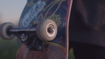 Skater rolling wheel on skateboard