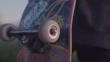 Skater rolling wheel on skateboard
