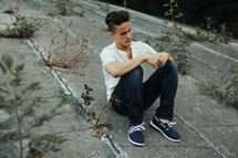 a man sitting on a concrete slope