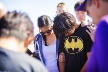 praying over a boy after a baptism