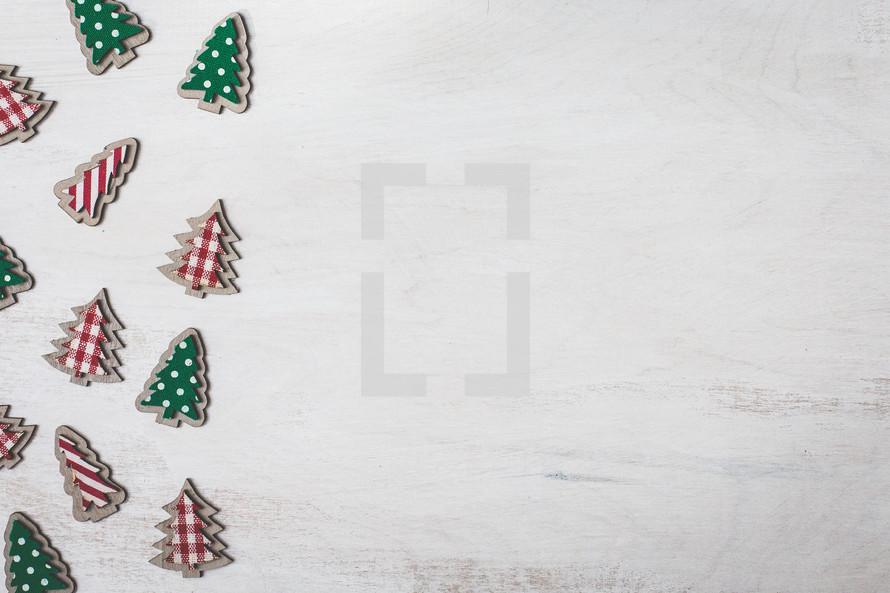 Christmas tree cutouts on white