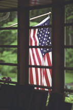 American flag out a window