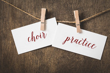 word choir practice  on card stock hanging on twine by a clothespin