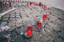 Memorial candles on paved a city street