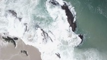 aerial view over waves in the ocean