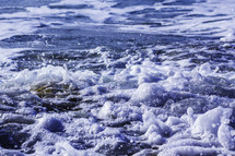 sea foam on a beach shore