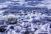 sea foam on a beach shore