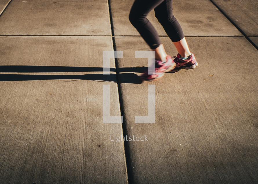 legs of a woman running
