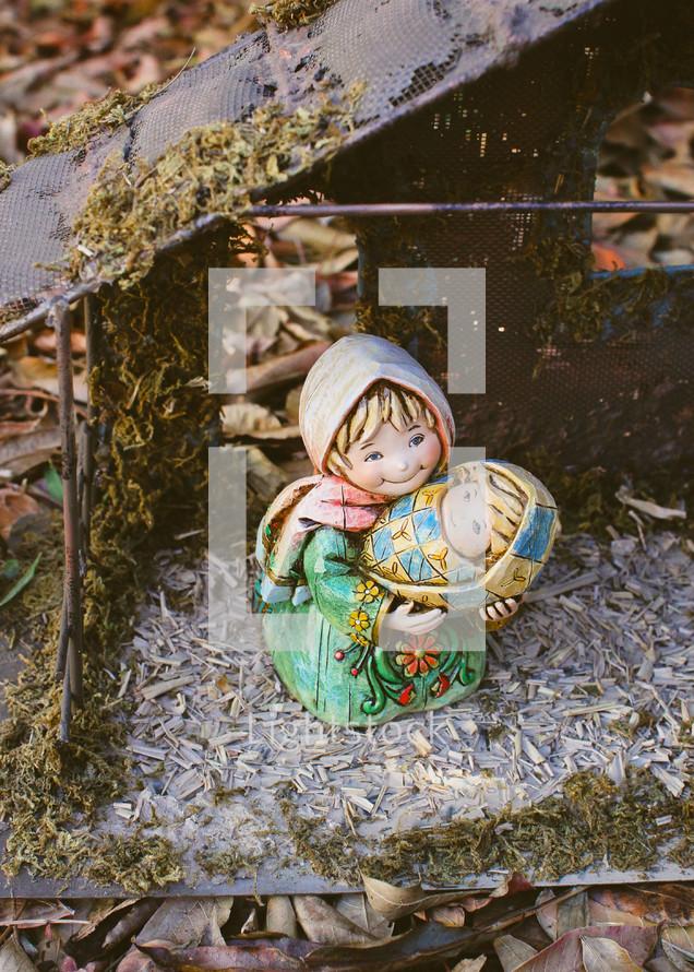figurines of Mary holding baby Jesus