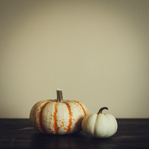 two pumpkins on a table