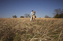 A couple embracing in a field