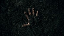 resurrection - hand reaching out of the ground
