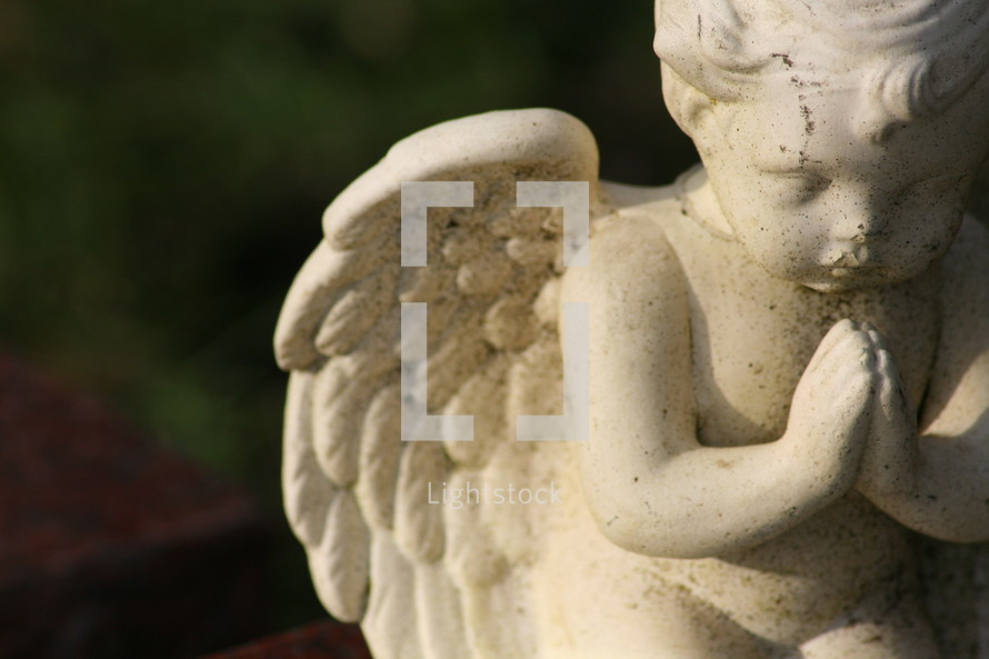 Praying cherub.