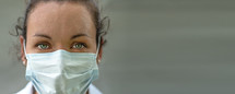 Doctor wearing protection face mask.