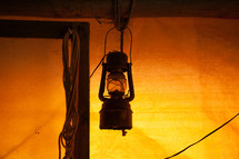 lantern hanging in a tent