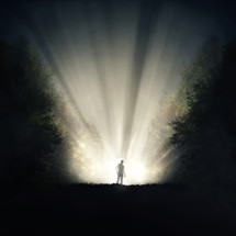 a shadow of a man standing in rays of light