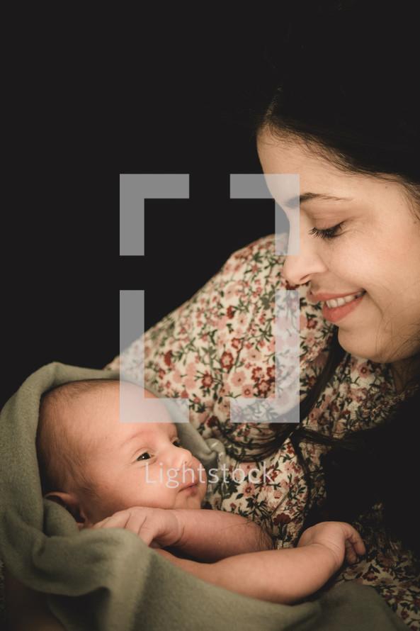 mother cradling a newborn baby