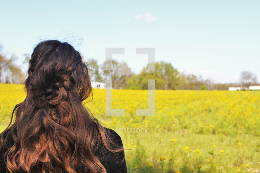 a woman looking into a meadow