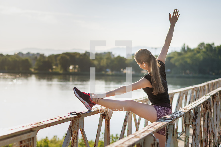 woman stretching before a jog