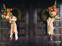 flowers and wreaths on front doors