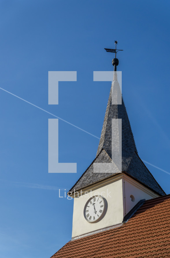 weather vane and clock on a steeple