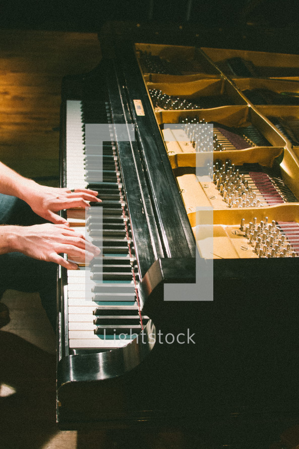 person playing a grand piano