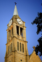 Steeple and clock tower of St. Dennis church.