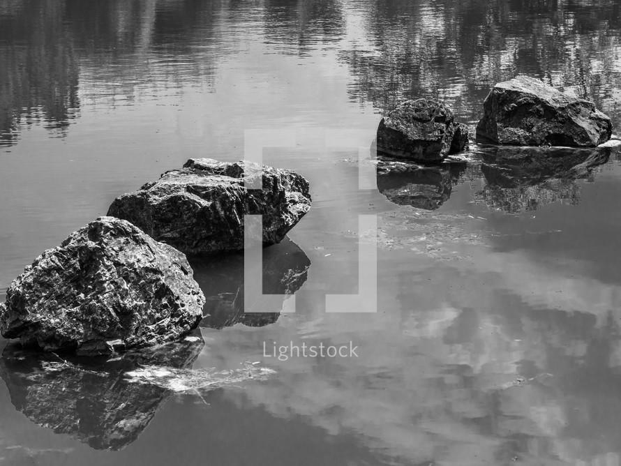 four rocks in water