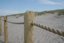 a rope fence on a beach