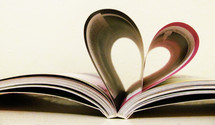 A book forms a heart with its pages.