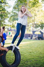teen girl on a tire swing
