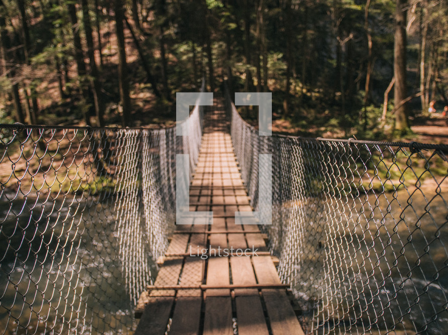swinging bridge over a river