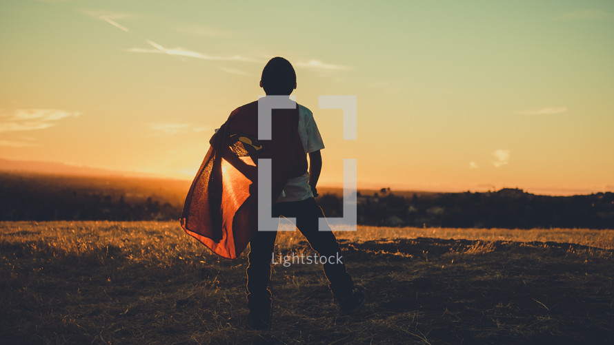 Boy looking up toward the sky wearing a superman cape. Imagination | Dreaming | Destiny | Vision| Heroes | Justice | Kids Ministry | Movies | Heroes | Bravery | Brave | Courage | Courageous | Strong | Strength | Stand | Determination | Persevere | Sermon Series |