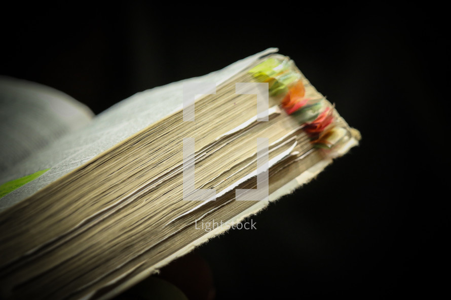 bookmarks and tabs in the pages of a Bible