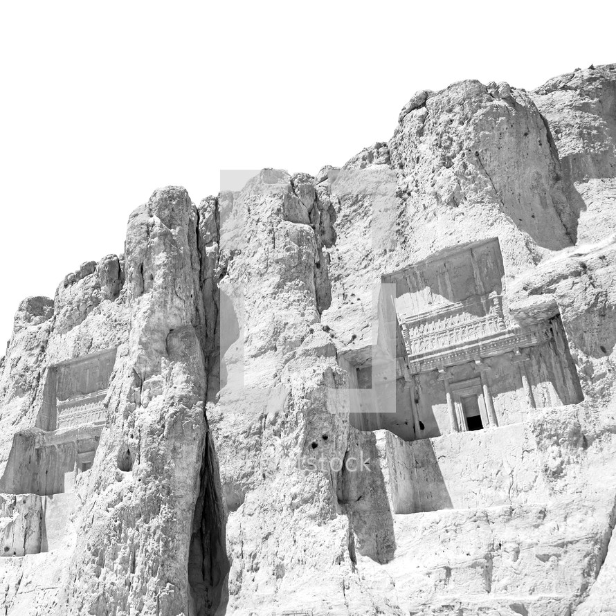 buildings carved into a mountainside in Iran