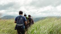 hiking through tall grass