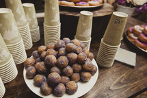 Plate of donut holes with cups
