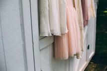 bridesmaid dresses hanging on a barn