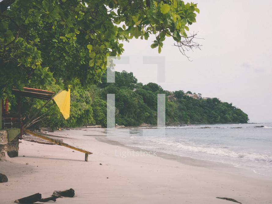yellow flag on a beach