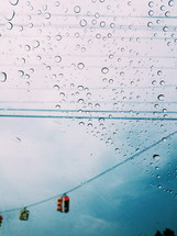rain on a car window and stoplights