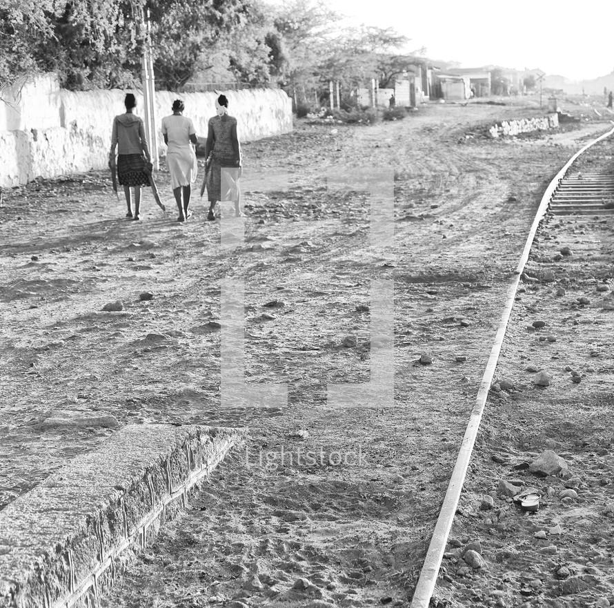 people walking on a dirt road in Ethiopia