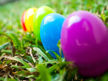 Colorful easter eggs in grass