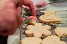 Decorating sugar cookies.