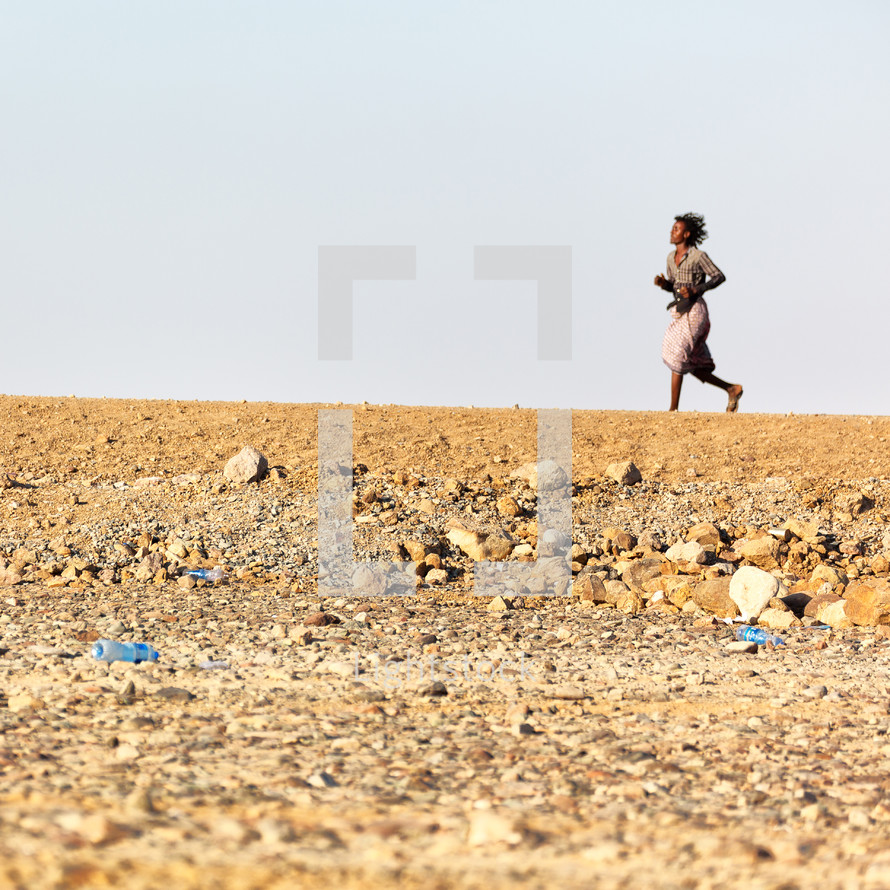 woman running across a desert