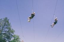 guys ziplining