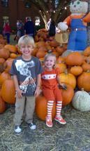 happy children in a pumpkin patch in October