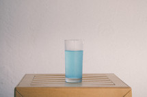 glass of blue water